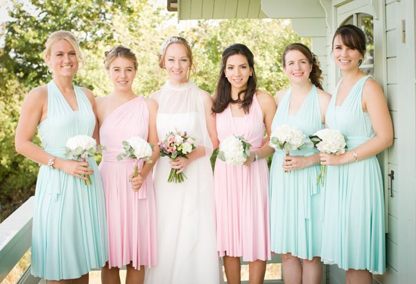 bridesmaids wearing rainbow colours